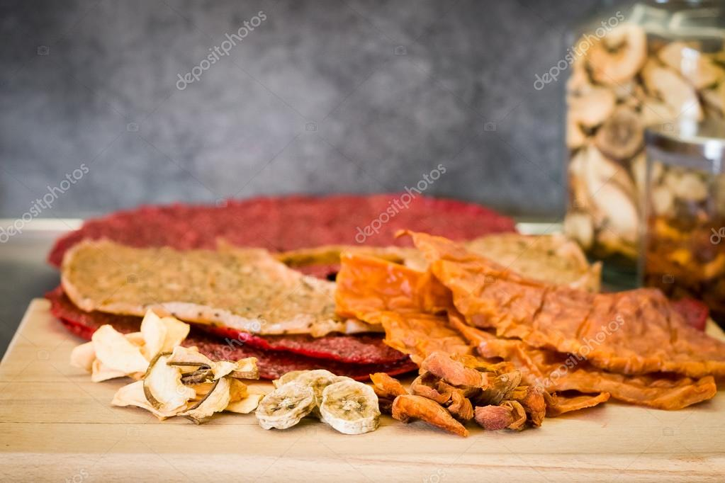Various types of dried fruits on the kitchen table — Stock