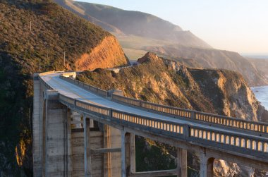 Bixby arch bridge on Cabrillo highway next to Big Sur California state park in sunset light