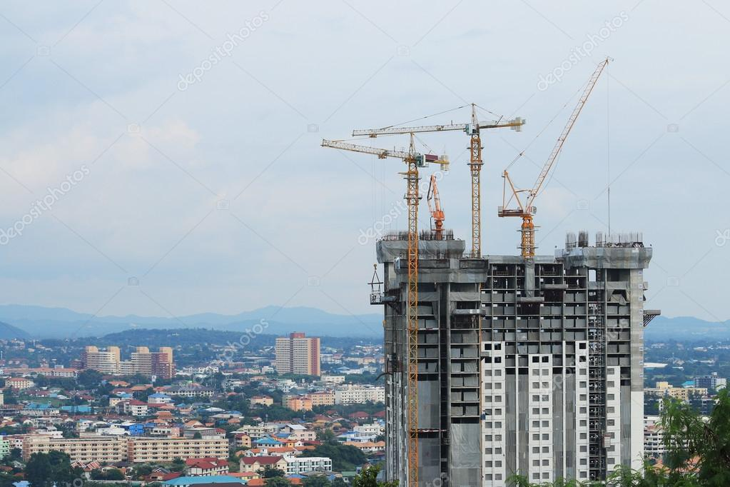 Construction cranes working on building