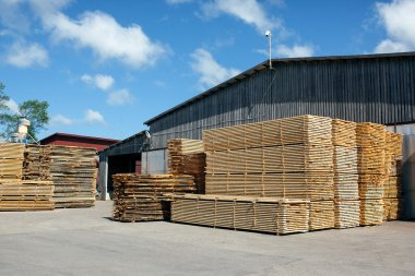 Piles of stacked rough cut lumber at a sawmill
