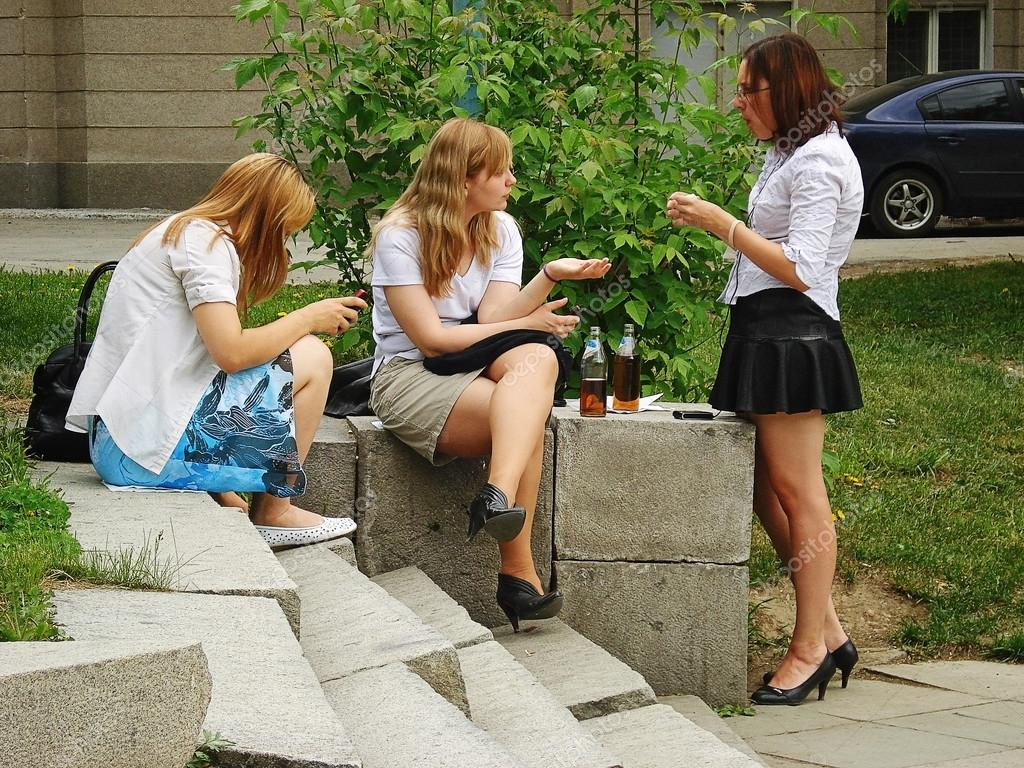 Yekaterinburg, Russia May 26, 2010: Three young girls drink be