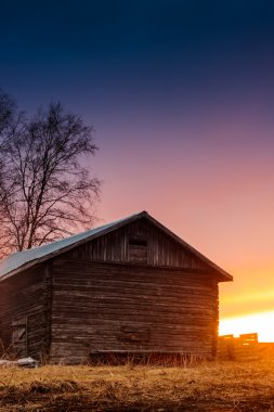 Sunset Behind A Barn House