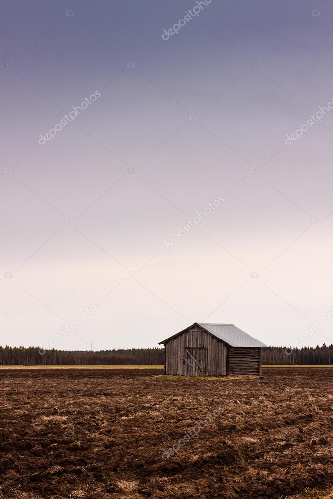 Old Barn On An Empty Field