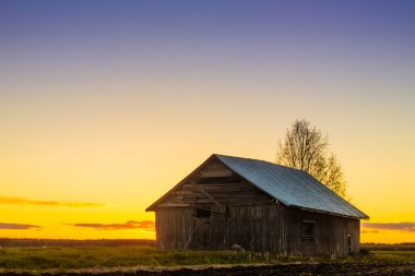 Barn House Against The Spring Sunset