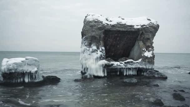 Dramatic frozen demolished forts ruins in Baltic sea, Liepaja, Latvia