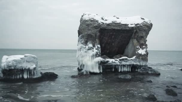 Dramatic frozen demolished forts ruins in Baltic sea, Liepaja, Latvia