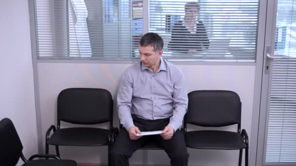Middle-aged man sitting in the waiting room