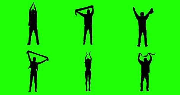 Jubelnden Fans auf grünen Bildschirm. Silhouetten