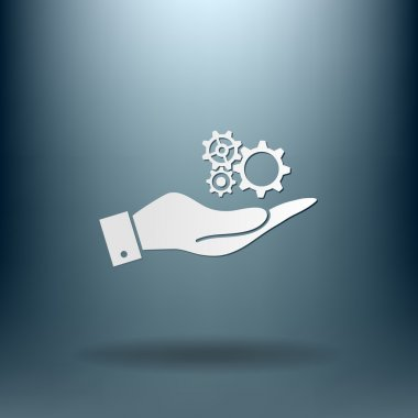 hand holding a symbol settings. cogwheel