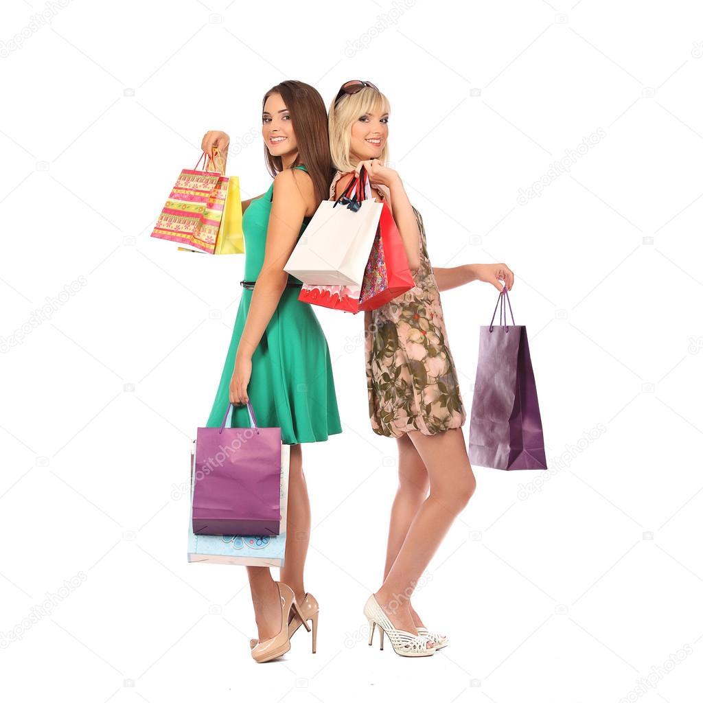 6d7f4f0ed6 Εμπορικά καταστήματα και τουριστικές έννοια - όμορφα κορίτσια με τσάντες–  εικόνα αρχείου