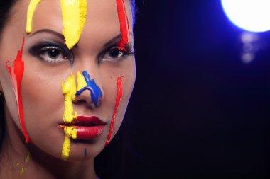 Portrait of a woman painted conceptual body art