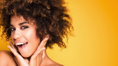 Beauty portrait of smiling girl with afro.