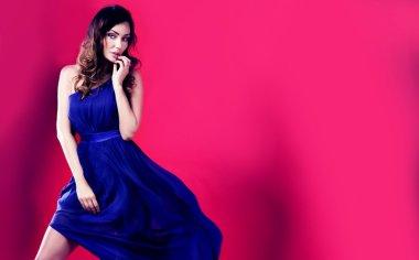 Beautiful brunette iin long dress