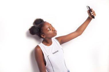Teenage girl with mobile phone.
