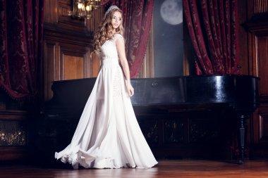 Beautiful bride in white dress.