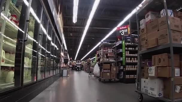 Snellville, Ga USA - 08 15 20: Walmart Neighborhood Market grocery store covid-19 pandemic  carts of stock on the back aisle floor covid-19 directions to shop
