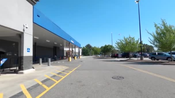 Augusta, Ga USA - 04 21 21:  Rear pan of Sams wholesale club retail store entrance with people and gas price 2.47