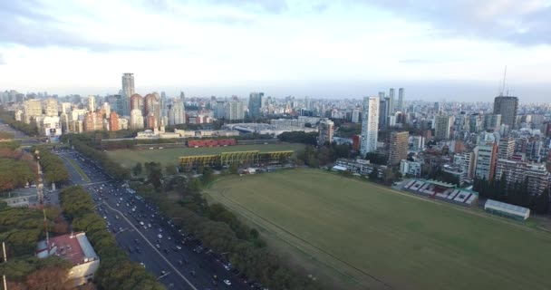Aerial drone scene of polo field and city landscape. Equine, horse sport field. Stadium and avenues with cars can be seen. City of Buenos Aires, Argentina.