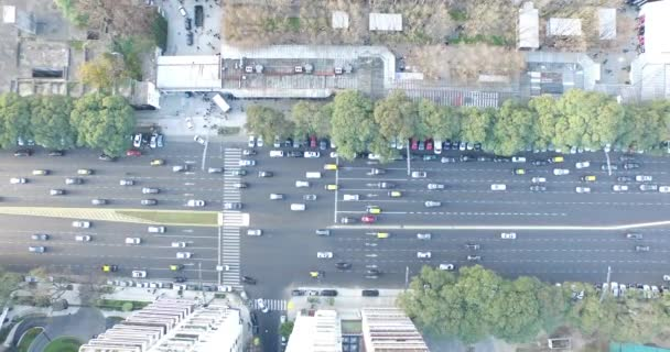 Aerial, top drone scene of city traffic. Cars, trucks, public transport and pedestrians movement are filmed.