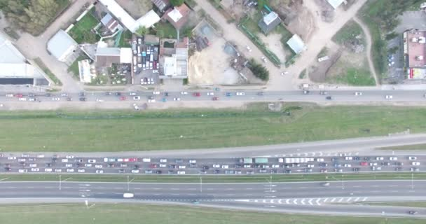 Aerial drone scene of jamed highway. Top view of traffic in the road.