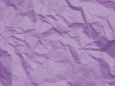Crumpled light purple paper texture background