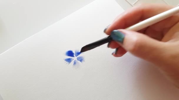 Painting flower with watercolors close up