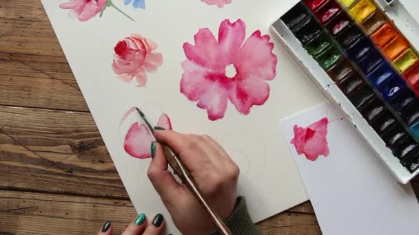 Painting pink flower with watercolors close up