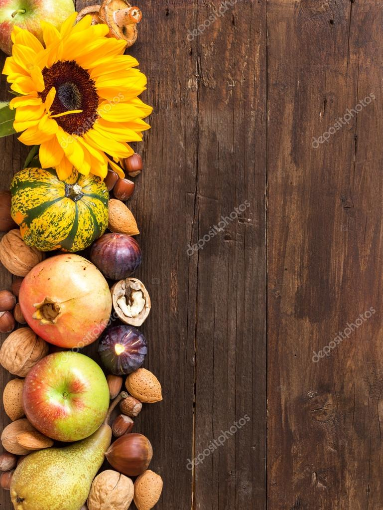 Autumn border on a wooden table