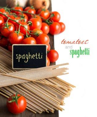 Spaghetti, tomatoes and small chalkboard