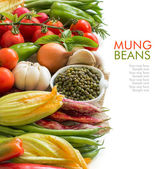 Raw organic mung beans in a bowl and vegetables