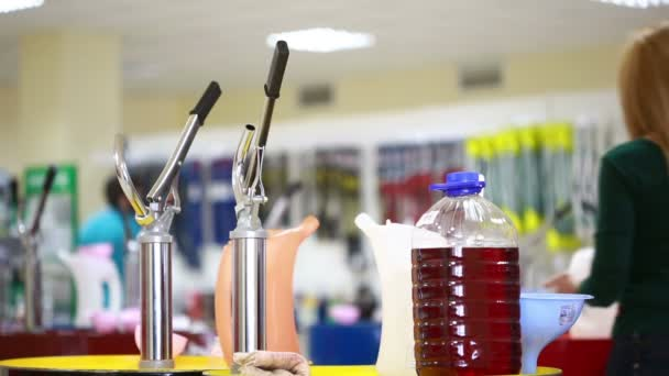 shoppers in the store choosing engine oil. motor oil in auto store
