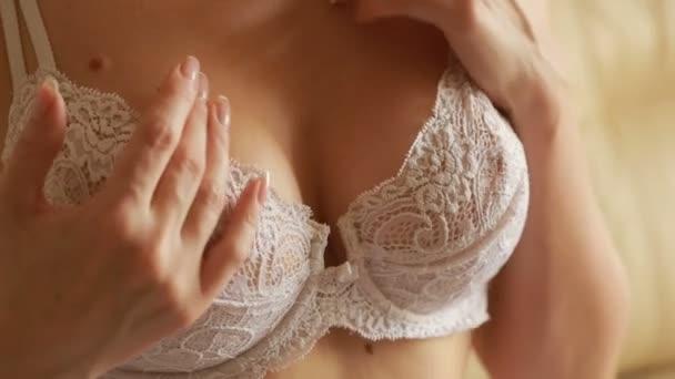 woman stroking her breasts. Underwear. sex games. close-up