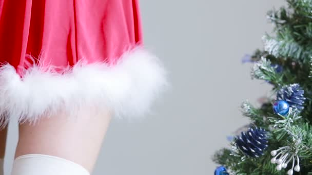Sexy Santa Girl caresses herself. sex games. hands in handcuffs