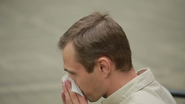 Young man holding handkerchief on nose. a man has a bad cold