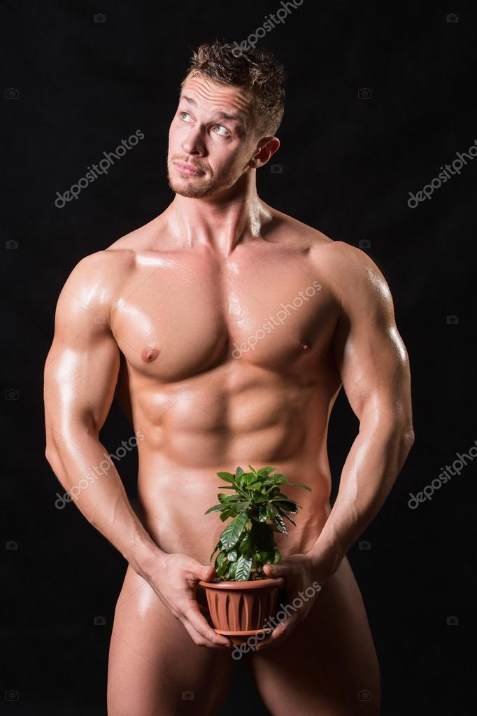 bodybuilder holding a flower in a pot