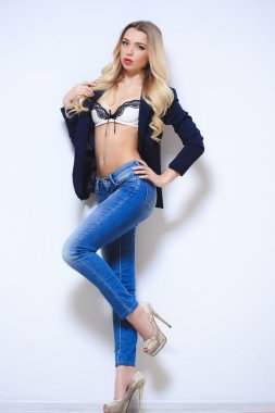 Beautiful blonde in a lingerie and jeans