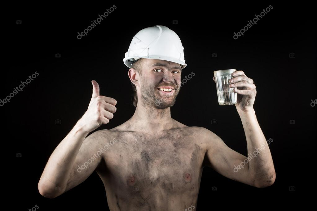 a miner with a glass of vodka