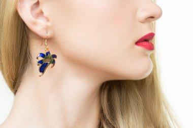 Close up of beautiful woman wearing shiny diamond earrings stock vector