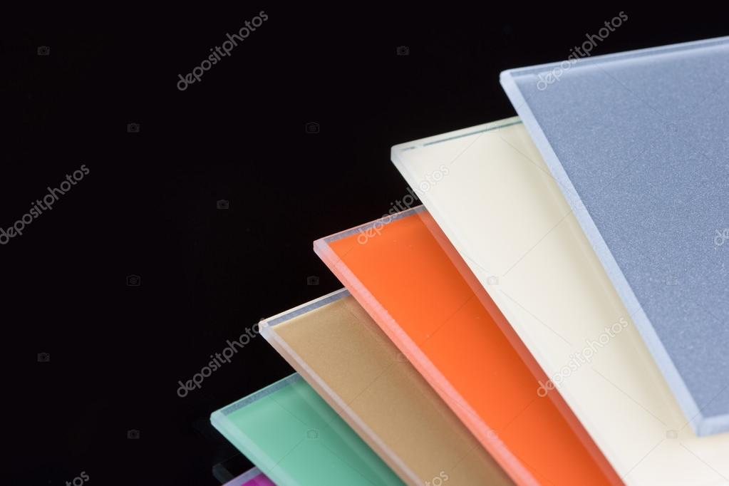 a stack of colored glass on a black background design glass sheets photo by kopitin - Colored Glass Sheets