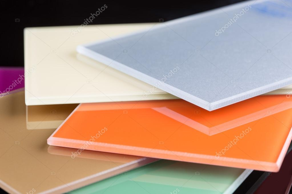 a stack of colored glass on a black background. glass sheets — Stock ...