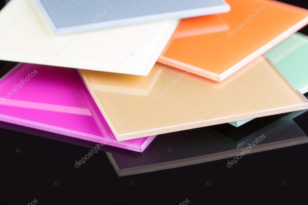 A Stack Of Colored Glass On A Black Background Glass Sheets Stock