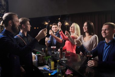 People in the bar. night club. sparklers