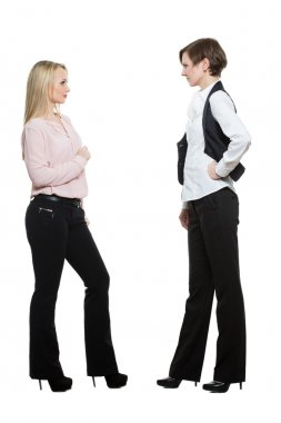 two businesswomen, isolated on white background. body language, gestures psychology. paired gestures. conflict situation. aggressive posture ready. negativity
