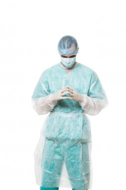 Surgeon portrait. isolated on white background. focuses on reflection. fingers pyramid. praying