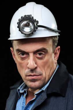 coalminer holds out a large chunk of energy rich coal