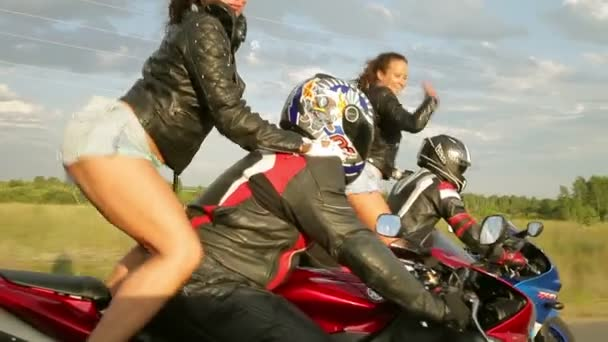 Dancing girl on a motorcycle