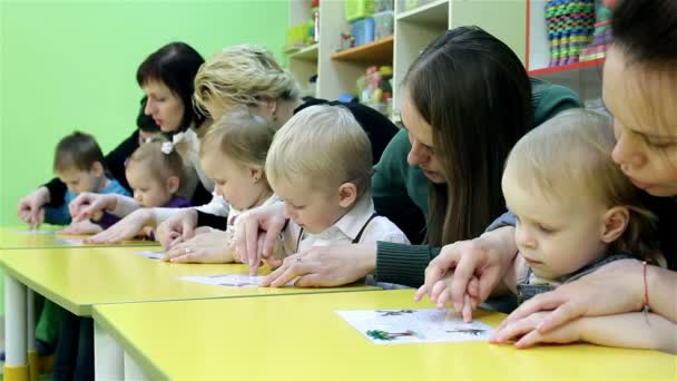 Small children and their mothers engaged in the development of intelligence