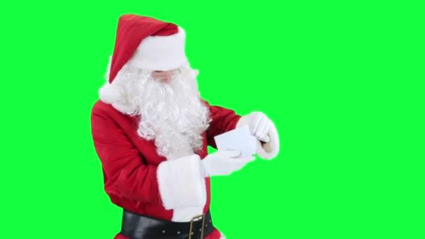 Santa Claus reading a letter chroma key (green screen)