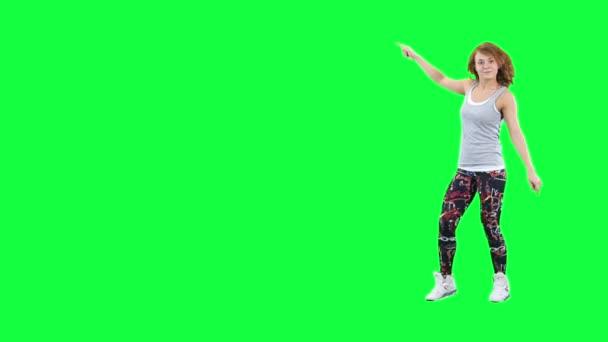 Tanečník inzeruje něco izolovaných na zelené