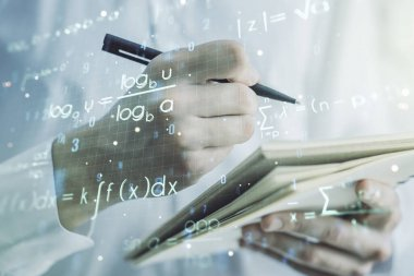 Creative scientific formula concept with man hand writing in notebook on background. Multiexposure